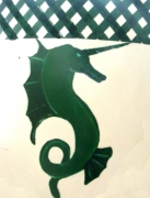 Device: Argent, a unicornate natural seahorse erect to sinister vert, a chief vert fretty argent